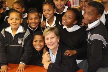 Minister Anroux Marais with learners from Avian Park Primary School
