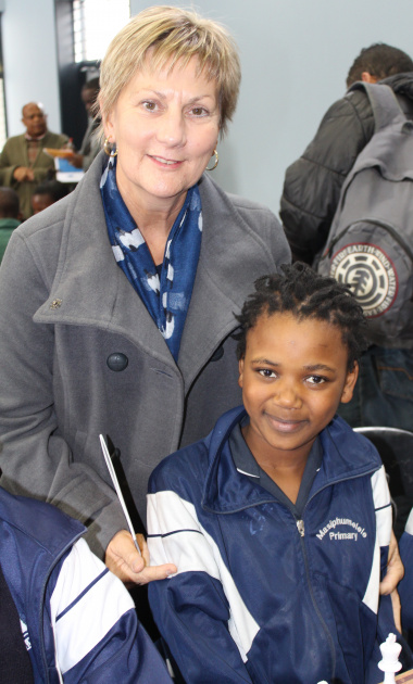 Minister Anroux Marais with Sinoxolo Sokoyi from Masiphumelele Primary School, the winner of chess in her category at the 2014 Top Schools Competition.