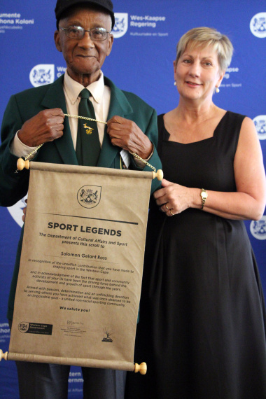 Minister Anroux Marais with Solomon Ross, an athletics legend