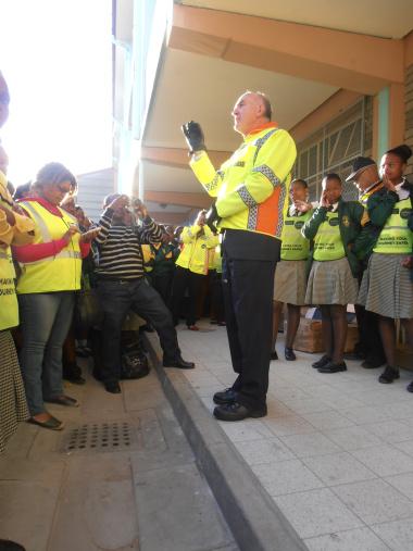 Minister Carlisle addresses pupils at Dr Nelson Mandela High School.