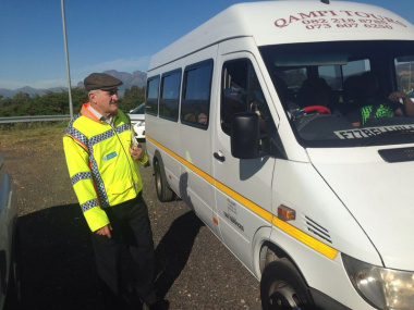 Minister Robin Carlisle interacting with motorists at the launch of the Easter Operational Plan.