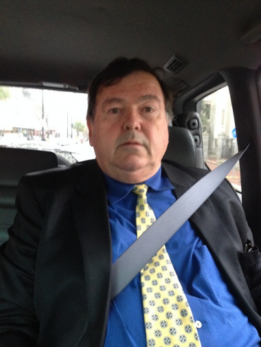 Minister Donald Grant uses a seatbelt.