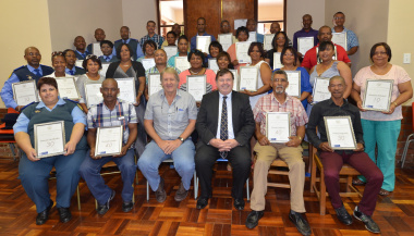 Minister Donald Grant with the proud recipients of the Eden/Central Karoo Long Service Awards.