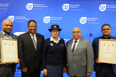 Minister Albert Fritz with officials from the South African Police Service.