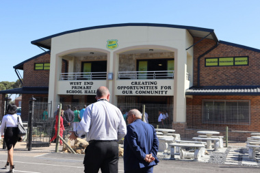 Minister Fritz in front of West End Primary School