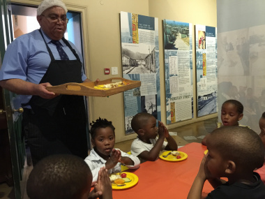 Minister Fritz serves lunch meals to cute ECD kids