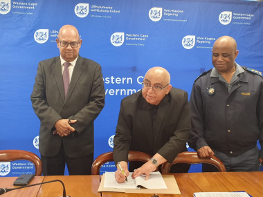 Minister Albert Fritz signing the directive