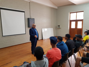 Minister Fritz speaking to learners