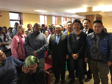 Minister Fritz with elderly residents and Chinese business owners