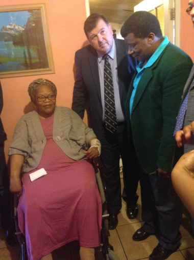 Minister Grant and Mandla Mata from SANTACO with Ms Miriam Letsaba who sustained a spinal cord injury during a crash.