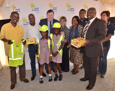 Minister Grant and RAF Board Members handed out reflective vests to primary school children.