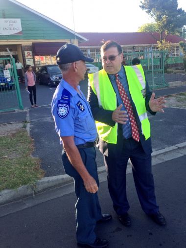 Minister Grant and Richard Coleman, a senior City traffic officer at the Scholar Transport Operation at Blossom Primary School Athlone.