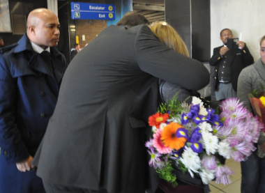Minister Grant consoles Tania, the wife of Mr Botha.