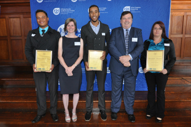 Ms Jacqui Gooch and Minister Donald Grant with three of the 86 award recipients.