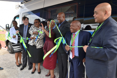 Minister Grant, Minister Peters and Deputy Minister Chikunga officially cutting the ribbon for the new RAF mobile office.