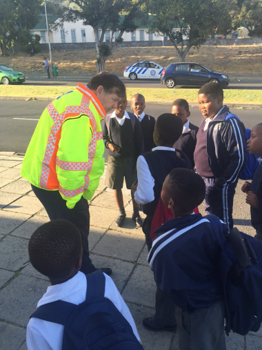 Minister Grant talking to learners about their safety at this morning's scholar transport operation.
