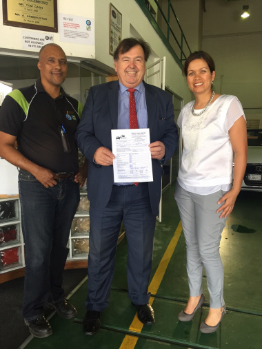 Minister Grant with Joy Oldale from RMI and a testing officer from the facility.