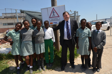 Minister Grant with Itsitsa Primary School learners during the unveiling of the Child Pedestrian Safety posters.