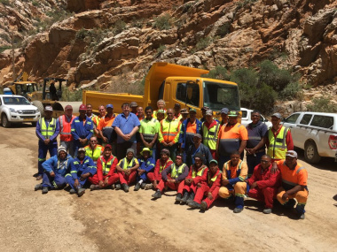 Minister Grant with workers during a recent visit to the Pass.