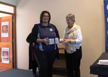 Minister hands over DVDs to Senior librarian of Laingsburg Library, Francisca Jansen