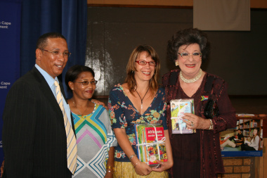 Minister Ivan Meyer handing over books to Evita Bezuidenhout and representatives of the Darling trust.