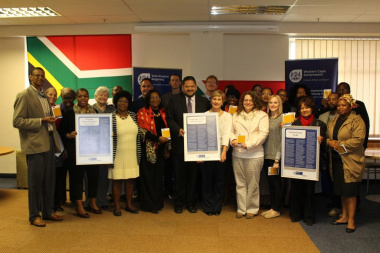 Minister Marais and Brent Walters with the members of the Western Cape Provincial Language Forum with the Language Code of Conduct