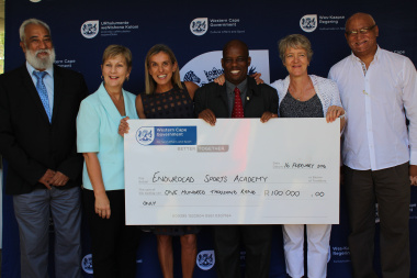 Minister Marais and dept officials hand over cheque to Elana Meyer and Janet Welham