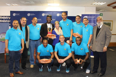 Minister Marais and Deputy Director Henry Paulse with the Mountaineers Basketball Club