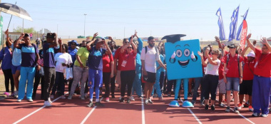 Minister Anroux Marais and DCAS HOD Brent Walters join Team DCAS in the march-pass at the Metro Better Together Games in Bluedowns