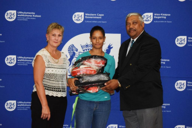 Minister Marais and Mayor Harold Cleophas handing over sporting equipment to the Moorreesburg Kickboxing Club.