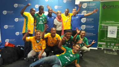 Minister Anroux Marais with South Africa's 2017 Homeless Street Soccer World Cup