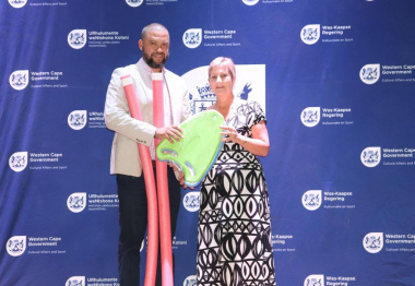 Minister Anroux Marais handing over sporting equipment to the Eden Aquatics Development Club as part of the DCAS Club Development Programme
