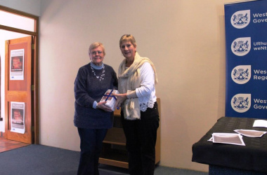 Minister Marais hands DVDs over to Francis van Wyk from Laingsburg Flood Museum.