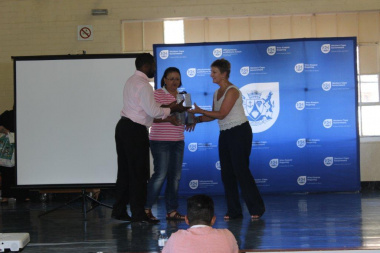 Minister Marais hands over DVDs to staff of Hangberg Library and Hout Bay Museum