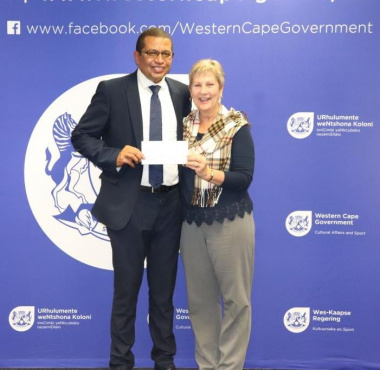 Minister Anroux Marais hands over sport funding to Cllr Barnito Klaasen of Witzenberg Municipality