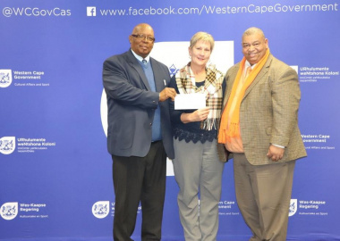 Minister Anroux Marais hands over sport funding to Cllr Mike Gouw and Pietie Williams of Laingsburg Municipality