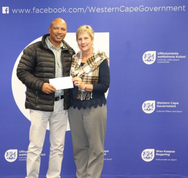 Minister Anroux Marais hands over sport funding to Edwin Marthinus of Theewaterskloof Municipality