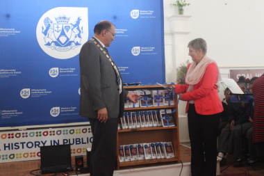 Minister Anroux Marais hands over the recordings to the Mayor of the Cape Agulhas Municipality