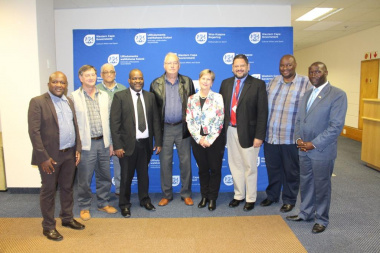 Minister Marais, HOD Brent Walters and Director Mxolisi Dlamuka with some of the newly appointed members
