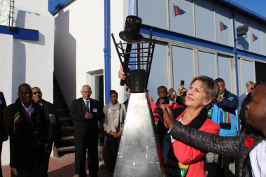 Minister Marais lights the torch in accordance with the Olympic tradition