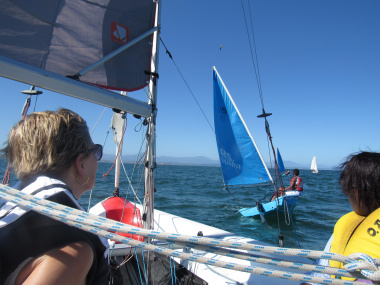 Minister Marais looks on as the children display their skill of sailing