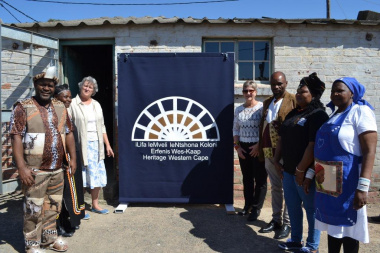 Minister Anroux Marais with board members and staff members before the official unveiling of the provincial heritage plaque of Llwandle Museum