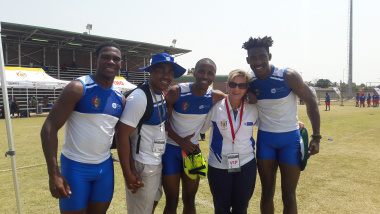 DCAS Minister Marais with Drie-stokkies players after Junior Mpefu (left of Minister Marais) set the record of 15.4m yesterday