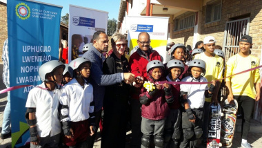 Minister Anroux Marais with excited children raring to test out the skatepark