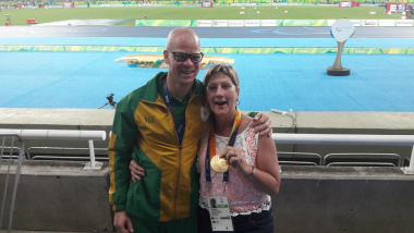 Minister Anroux Marais with Paralympian Hilton Langenhoven after he won the gold in the long jump event
