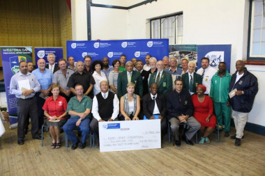 Minister Marais with other DCAS officials and the recipients of the cheq...