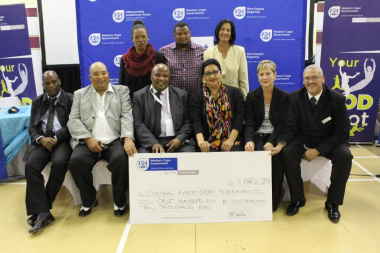 Minister Marais with other DCAS officials and the recipients of the cheque of R110 000