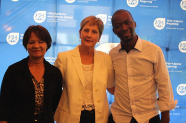 Minister Marais with previous winners Ria Olivier and Tamie Mbongo Thamsanqa