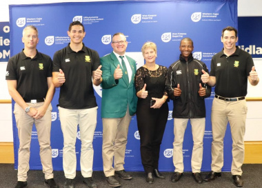 Minister Marais with some of the SA Ice Hockey Players and their coach, Johan Sundin and team manager Ben Denysschen.