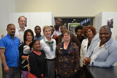 Minister Marais with staff at the Kwanonqaba library